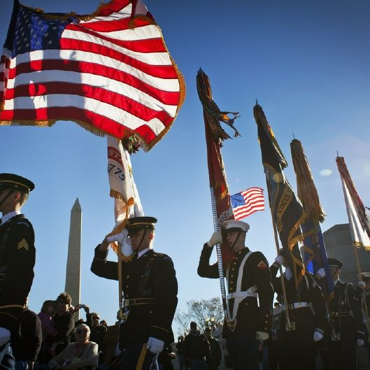 WASHINGTON, DC - NOVEMBER 11: The color guard makes its entrance at the Veterans Day ceremony at the National World War II Memorial November 11, 2010. (Photo by Dayna Smith/for the Washington Post)